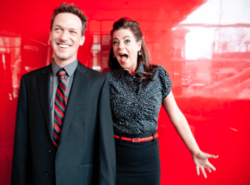 man wearing a suit and a woman posing for a picture