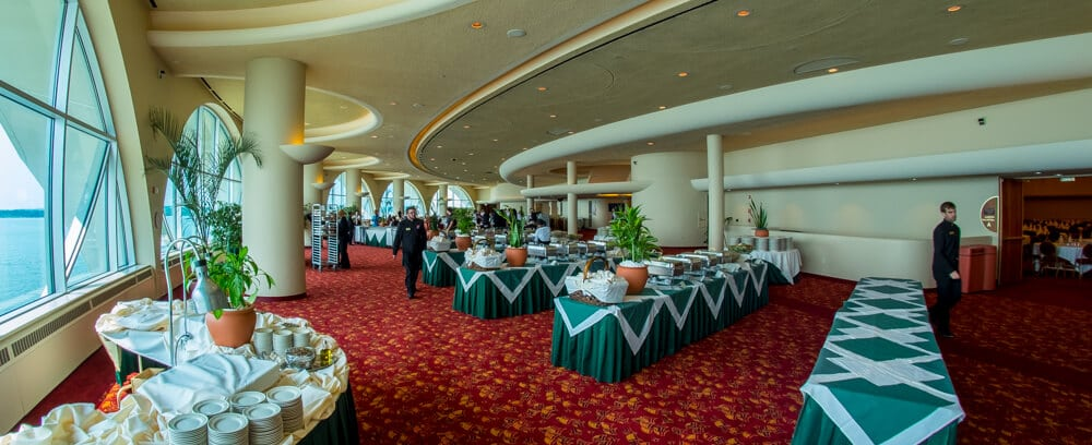 A view of Grand Terrace with buffet serving tables and staff members
