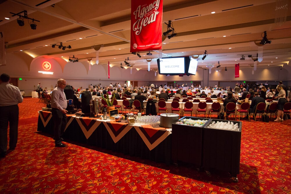 Madison Ballroom with people during an event, with a drink buffet and meeting tables