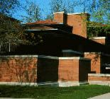 A side view of The Robie House that Frank Lloyd Wright built in 1909