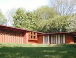 A tile red ranch-style house that Frank Lloyd Wright built in 1937.