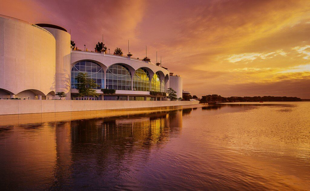 An artistic view of Monona Terrace from the lake at sunset