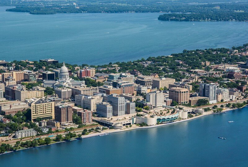 Aerial view of Madison with Lake Monona, city buildings and Monona Terrace standing out on the lakeshore