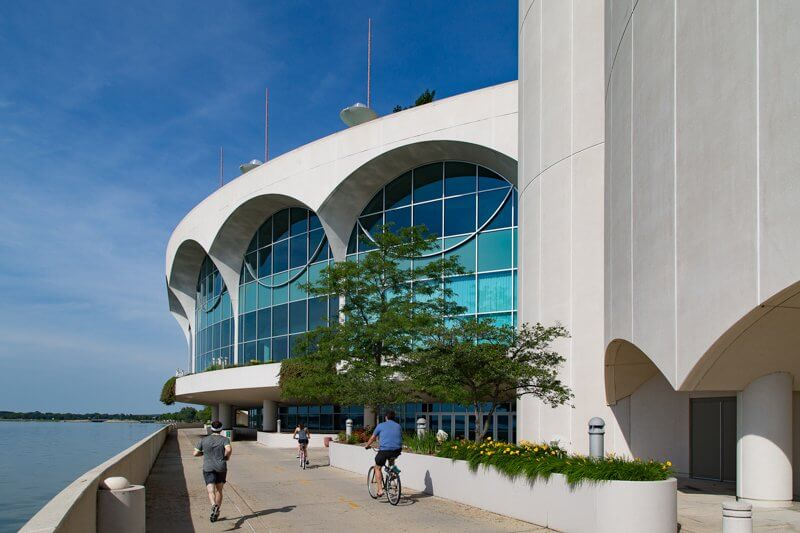 Monona Terrace side pathway with people jogging and riding their bikes