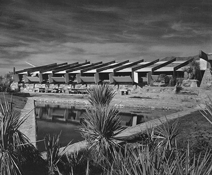 A black-and-white photograph by Guerrero of a view over the reflecting pool of Taliesin West designed by Wright.