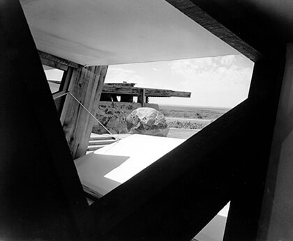 A black-and-white view of Taliesin West with canvas flaps designed by Wright.