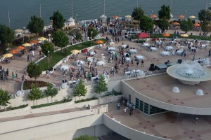 Aerial view of the rooftop terrace looking over the lake with a large event going on