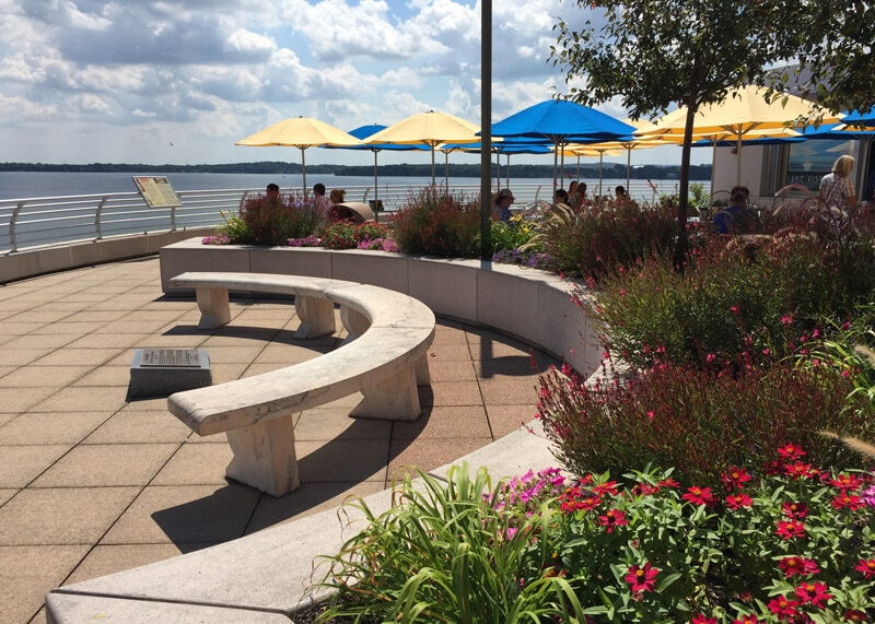 A stone bench next to Lake Vista Cafe with a view of the lake