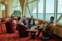 People networking in comfortable chairs at Monona Terrace during a break