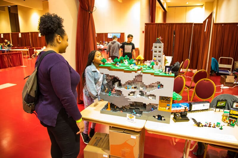 a mother and daughter admire a Lego model of a Minecraft game
