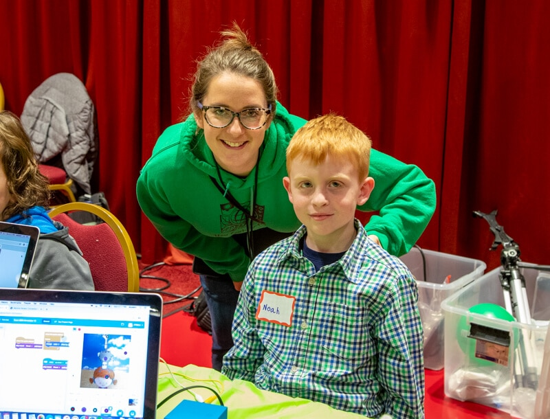 Mother and Student at Madison Maker Faire Presenting a project